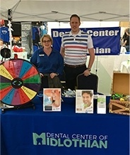Dentist and team members at community event