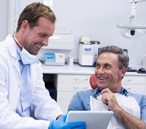 dentist speaking to patient