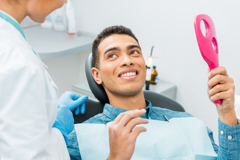 young man smiling in dentist chair