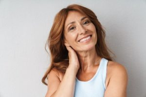 Woman with brown hair smiling with dental implants